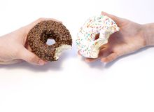 Donuts in hands collection, isolated on white background.Top view. royalty free stock photography