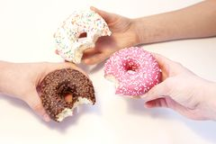 Donuts in hands collection, isolated on white background.Top view. stock images