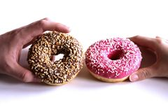 Donuts in hands collection, on white background.Top view. stock photography