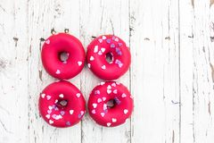 Donuts with heart sprinkles on white wooden background. Donut fo Royalty Free Stock Photo