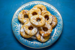 Donuts with a hole. On blue plate Stock Image