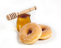 Donuts and honey Stock Images
