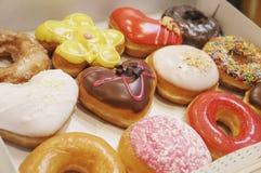 Donuts i asken royaltyfria bilder