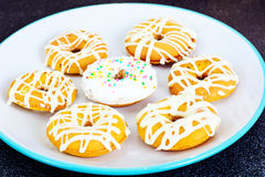 Donuts with Icing and Coconut Protein-Grained Color Stock Photography
