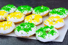 Donuts with Icing and Coconut Protein-Grained Color Stock Images