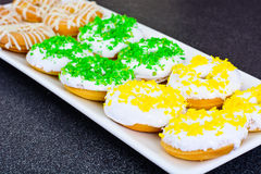 Donuts with Icing and Coconut Protein-Grained Color Stock Image