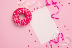 Donuts with icing on pastel pink background with copyspace. Sweet donuts. royalty free stock image