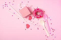 Donuts with icing on pastel pink background with copyspace. Sweet donuts. stock image