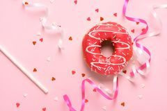Donuts with icing on pastel pink background with copyspace. Sweet donuts royalty free stock image