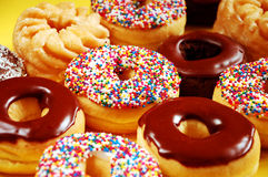 Donuts with icing and sprinkles. Assorted donuts with icing and sprinkles Stock Photography