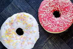 Donuts with icing an sprinkles landscape top Royalty Free Stock Photography