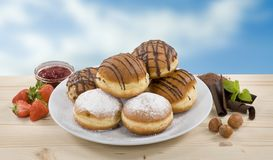 Donuts with jam and chocolate Royalty Free Stock Photography