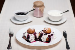 Donuts with jam and cream Stock Photography