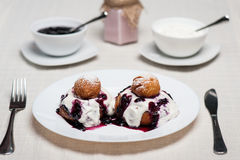 Donuts with jam and cream Stock Photos