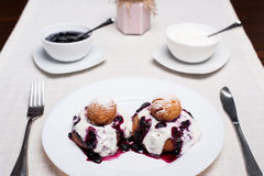 Donuts with jam and cream Stock Photo