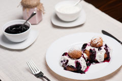 Donuts with jam and cream Royalty Free Stock Images