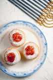 Donuts with jam on a plate with a blue rim and Hanukkah closeup. Vertical Royalty Free Stock Images