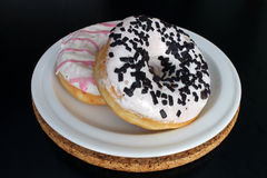 Donuts on kitchen table on a plate Royalty Free Stock Photography