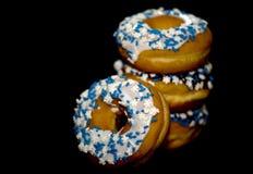 donuts kropią stertę Obrazy Royalty Free