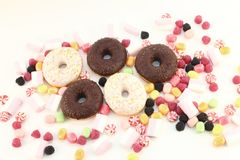 Donuts, many bright candies and marshmallows Royalty Free Stock Images