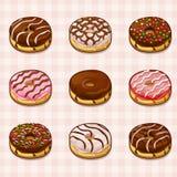 Donuts med olika fyllningar och glasyrer på kaka Arkivfoto