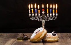 Donuts and a menorah for Hanukkah Royalty Free Stock Image