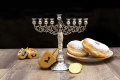 Donuts and a menorah for Hanukkah Royalty Free Stock Image