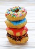 Donuts met kleurrijke glans Stock Foto's