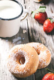 Donuts with milk and fresh strawberries Royalty Free Stock Photography
