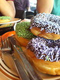 Donuts. With mint ceres topping and blueberries ceres topping Stock Images