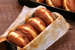 Donuts in mold. Traditional Polish cookies on Fat Thursday.  Stock Photo