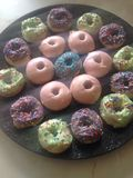 Donuts. Multicoloured sprinkle covered royalty free stock image
