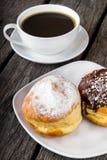 Donuts och kaffe arkivbilder