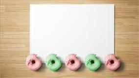 Donuts op Witboek op houten achtergrond royalty-vrije stock foto