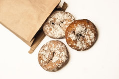 Donuts out of a paper bag Stock Photo