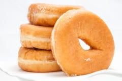 Donuts på vit bakgrund royaltyfria foton