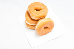 Donuts på vit bakgrund arkivfoto