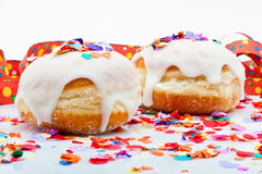 Donuts for a party isolated on white background with air streamers and confetti Royalty Free Stock Photos