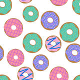 Donuts pattern. Vector illustration seamless pattern with colorful donuts with glaze and sprinkles on a white background. Vector illustration seamless pattern Stock Images