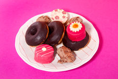 Donuts and petit four candy Stock Photos