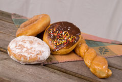 Donuts on picnic table Royalty Free Stock Photos