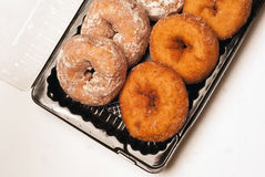 Donuts in a plastic container Royalty Free Stock Photos