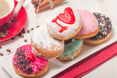 Donuts on a plate and coffee Stock Photography