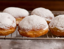 Donuts with powder sugar against dark background Royalty Free Stock Photo