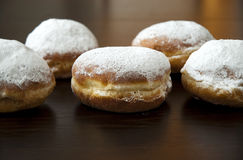 Donuts with powder sugar against dark background Royalty Free Stock Photography