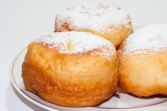 Donuts with the powdered sugar on the plate Royalty Free Stock Photo