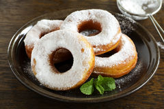 Donuts in powdered sugar. Stock Image
