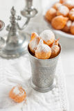 Donuts with powdered sugar on a white background Stock Image
