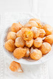 Donuts with powdered sugar on a white background Royalty Free Stock Photography