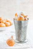 Donuts with powdered sugar on a white background Royalty Free Stock Photos